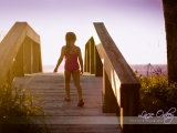 kylie-walking-up-the-beach_w | Naples Photographer Lacie Oakey